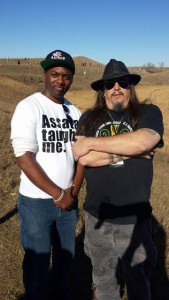 Sincere Kirabo and atheist activist Aron Ra together at the protests in Standing Rock, North Dakota.