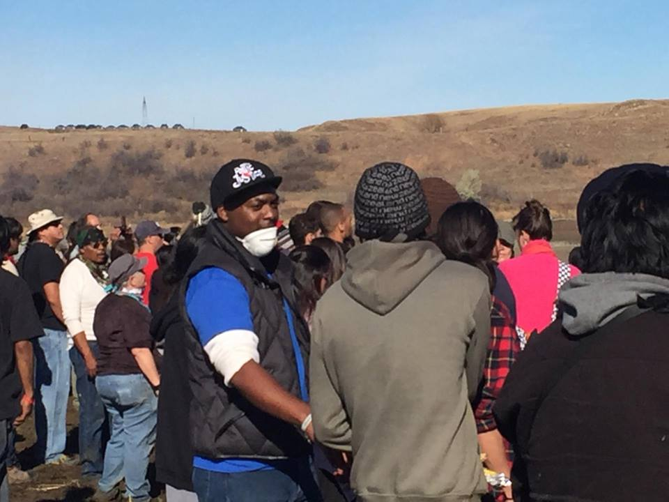 Photo of Sincere Kirabo in a crowd of protesters at Standing Rock, North Dakota.